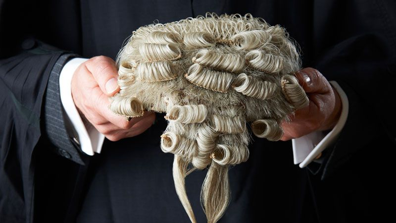 Judge holding wig